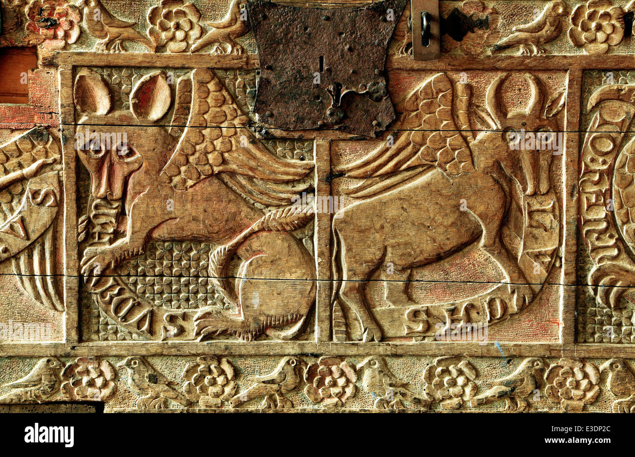 Dersingham, carved wood wooden 14th century chest, detail, symbols of 2 of the Four Evangelists, St. Luke and St.John, - Stock Image