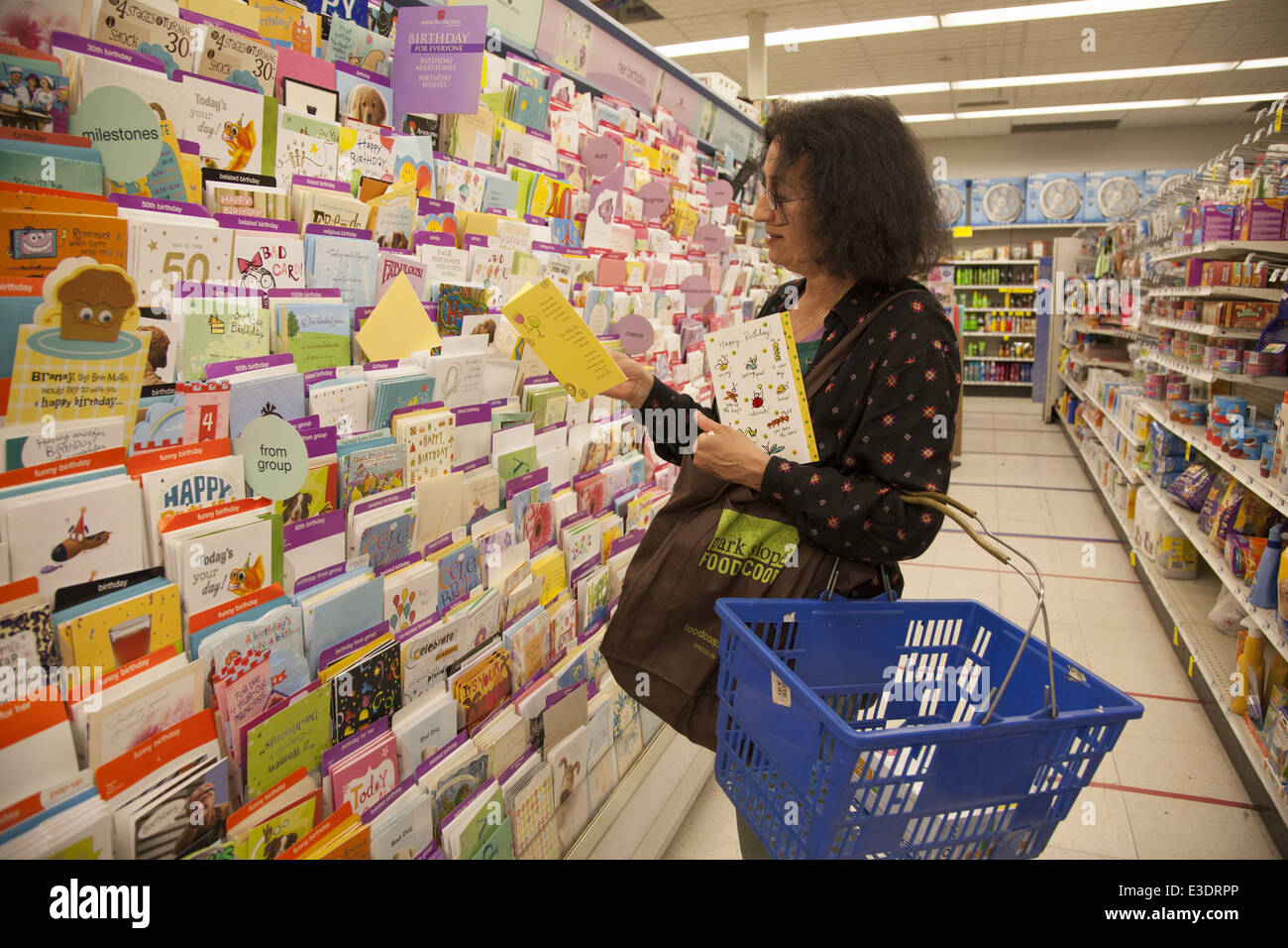Woman Shops For A Birthday Card At Large Pharmacy In New York City