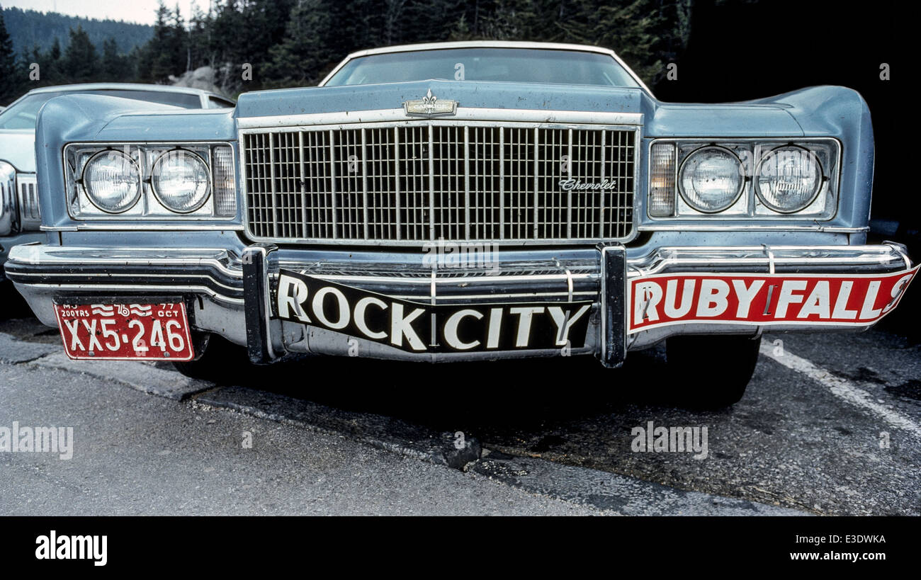 An automobile bumper carries wired-on advertisements for Rock City and Ruby Falls, two of the most publicized tourist - Stock Image