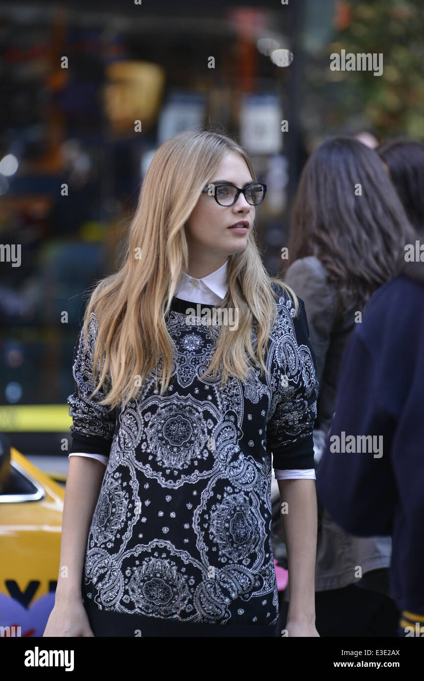 promo code 9ca28 9812c Cara Delevingne modelling on a photoshoot for Donna Karan's ...