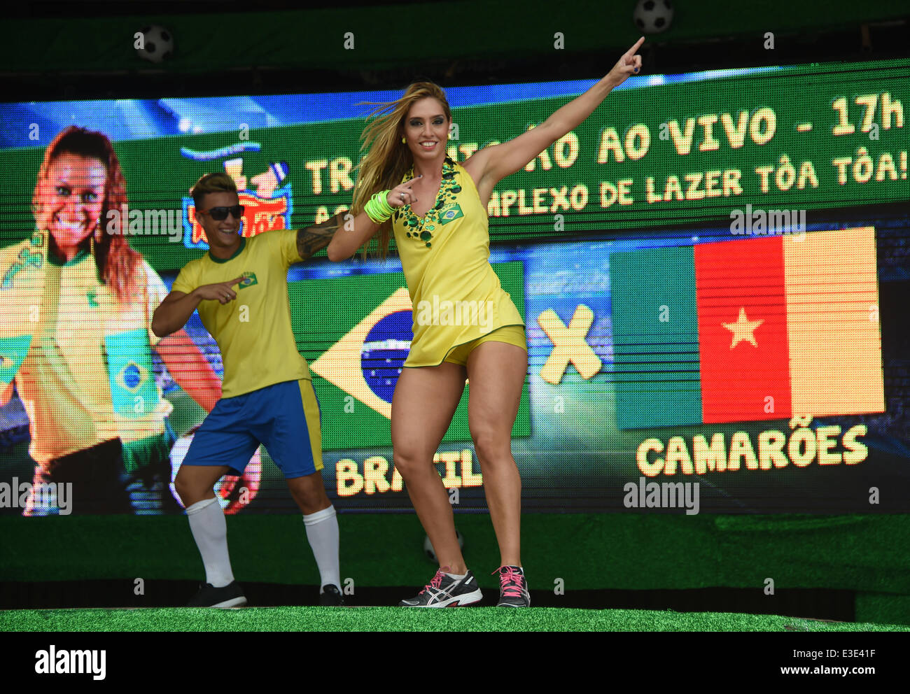 Porto Seguro, Brazil. 23rd June, 2014. Brazilian dancers perform on stage at a public viewing of the bar 'Toa - Stock Image