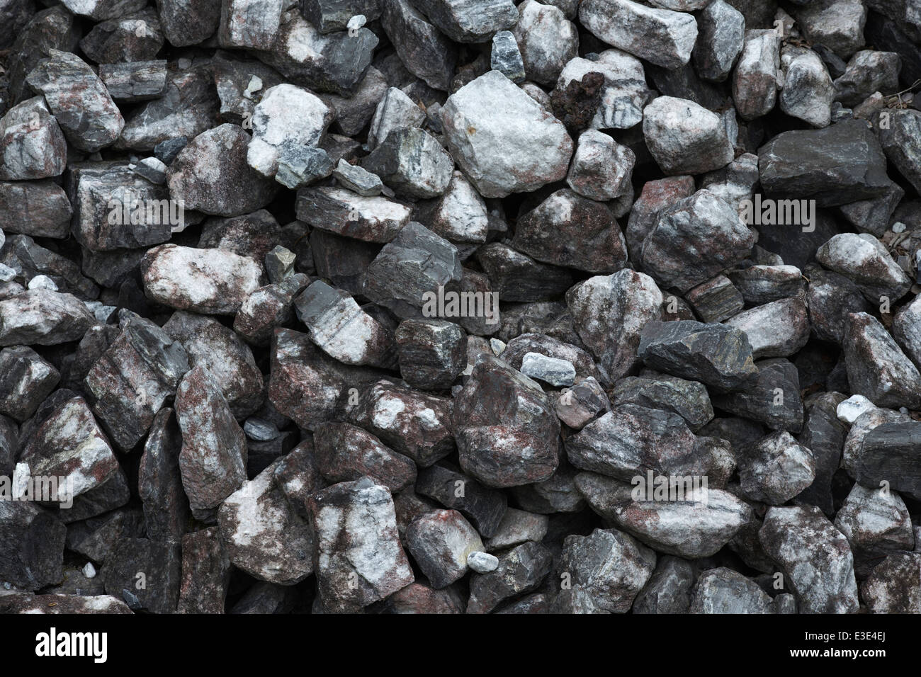 small marble stones in a quarry as background - Stock Image