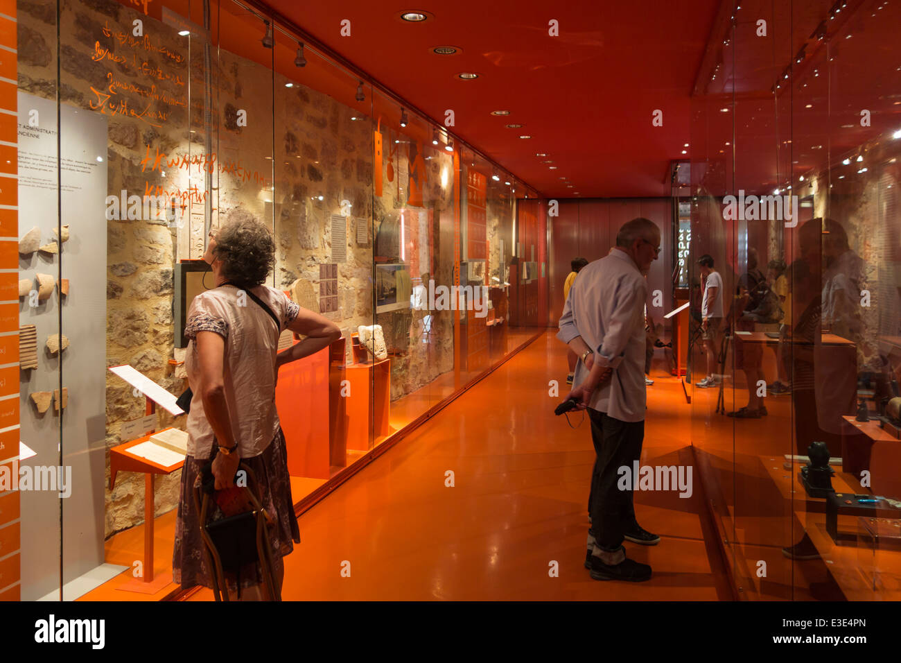 Tourists visiting the museum Musée Champollion about the history of writing at Figeac, Lot, Midi-Pyrénées, - Stock Image
