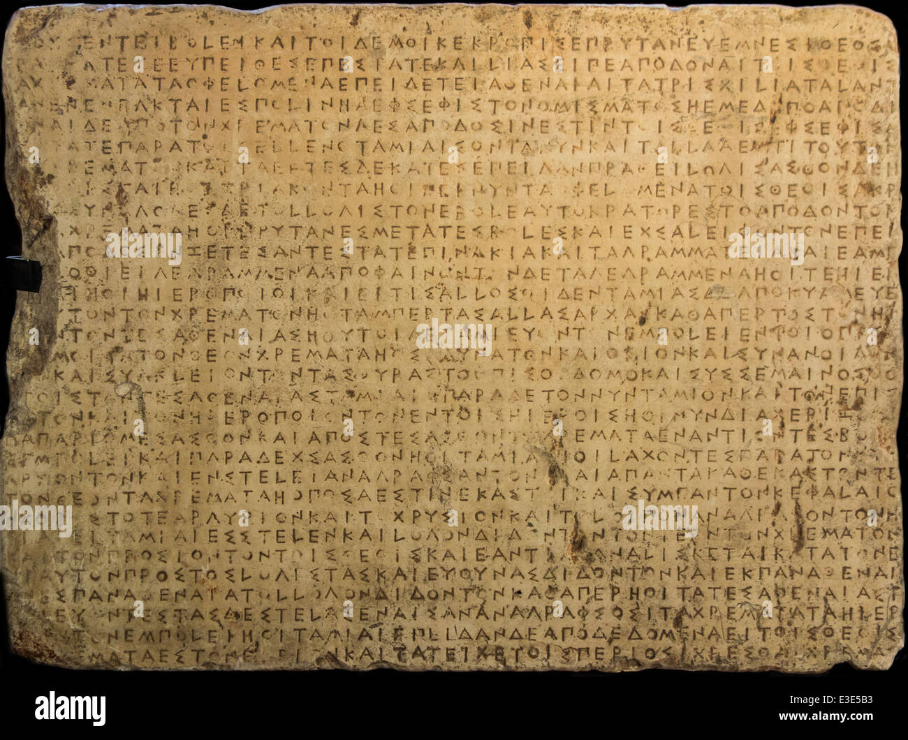 Stone slab showing the ancient Greek Callias Decree in stoichedon style of epigraphy - Stock Image