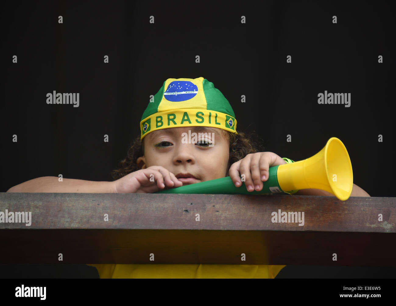 Porto Seguro, Brazil. 23rd June, 2014. A Brazilian kid is seen during a public viewing at the bar 'Toa Toa' - Stock Image