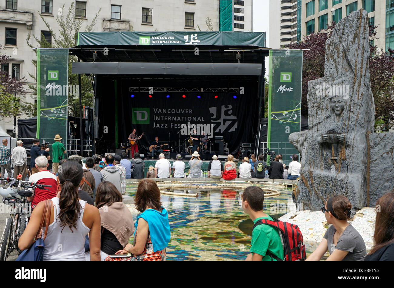 People watch a live performance by the Partisans, a jazz quartet from the United Kingdom, at the annual Vancouver - Stock Image