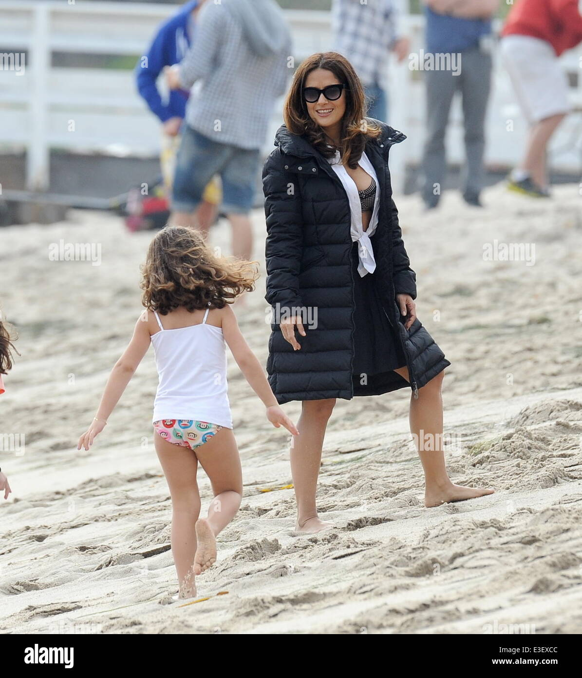 Salma Hayek shows off her curves on the beach for a scene