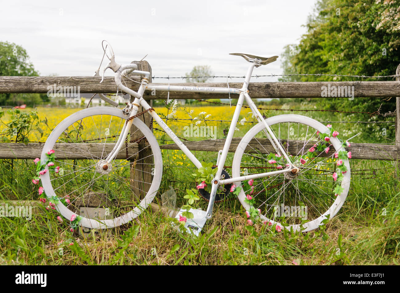 """Ghost Bike"" on a rural road in tribute to a cyclist killed in a road traffic accident. Stock Photo"