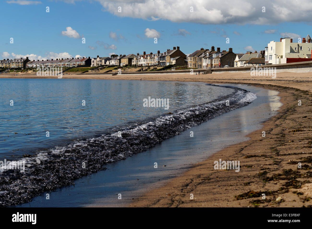 Black Sand on the beach in Newbiggin by the Sea in North East England - Stock Image
