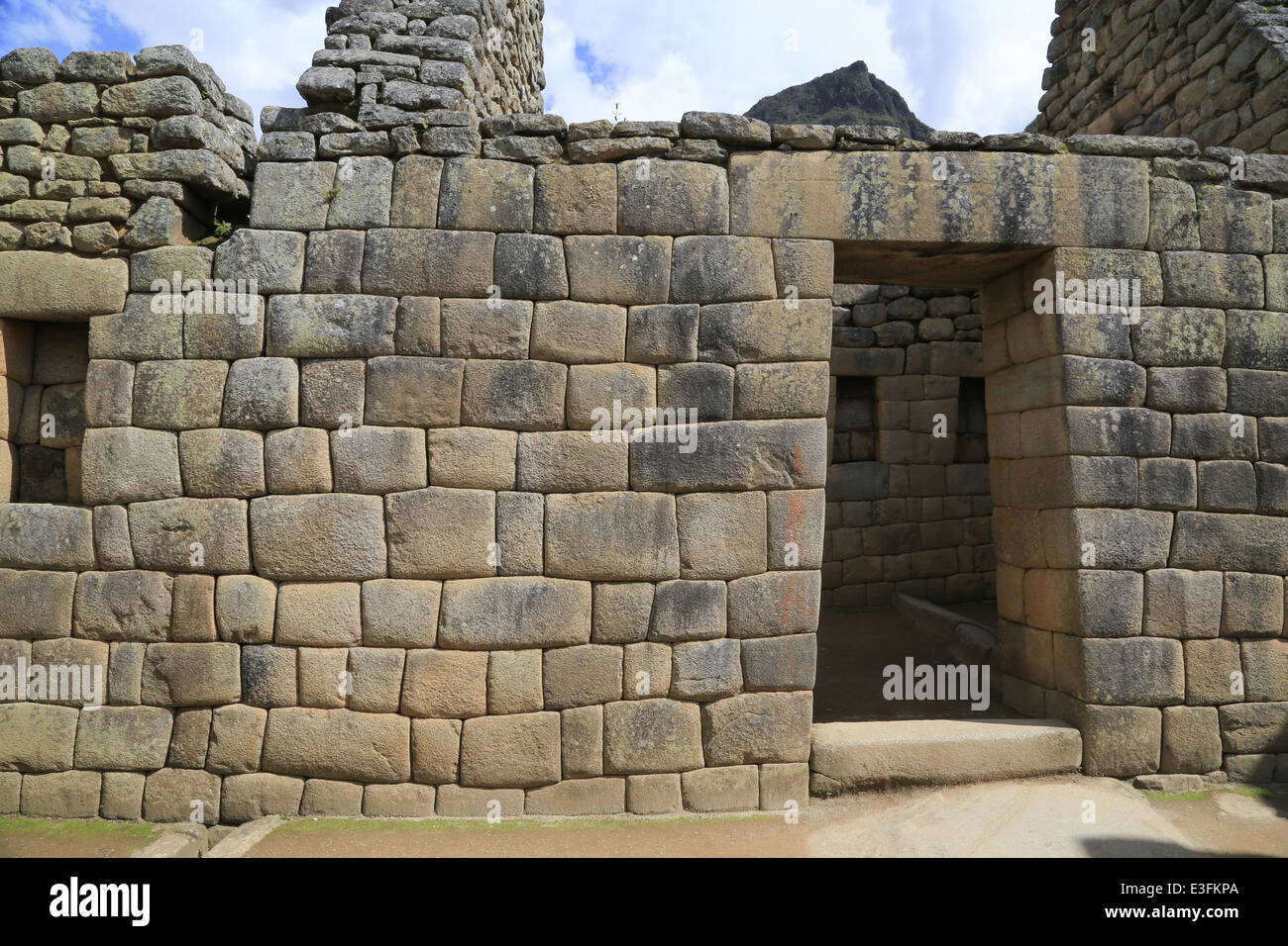 The trapezoidal arch stonework on the buildings at Machu Picchu, Cusco, Peru. - Stock Image