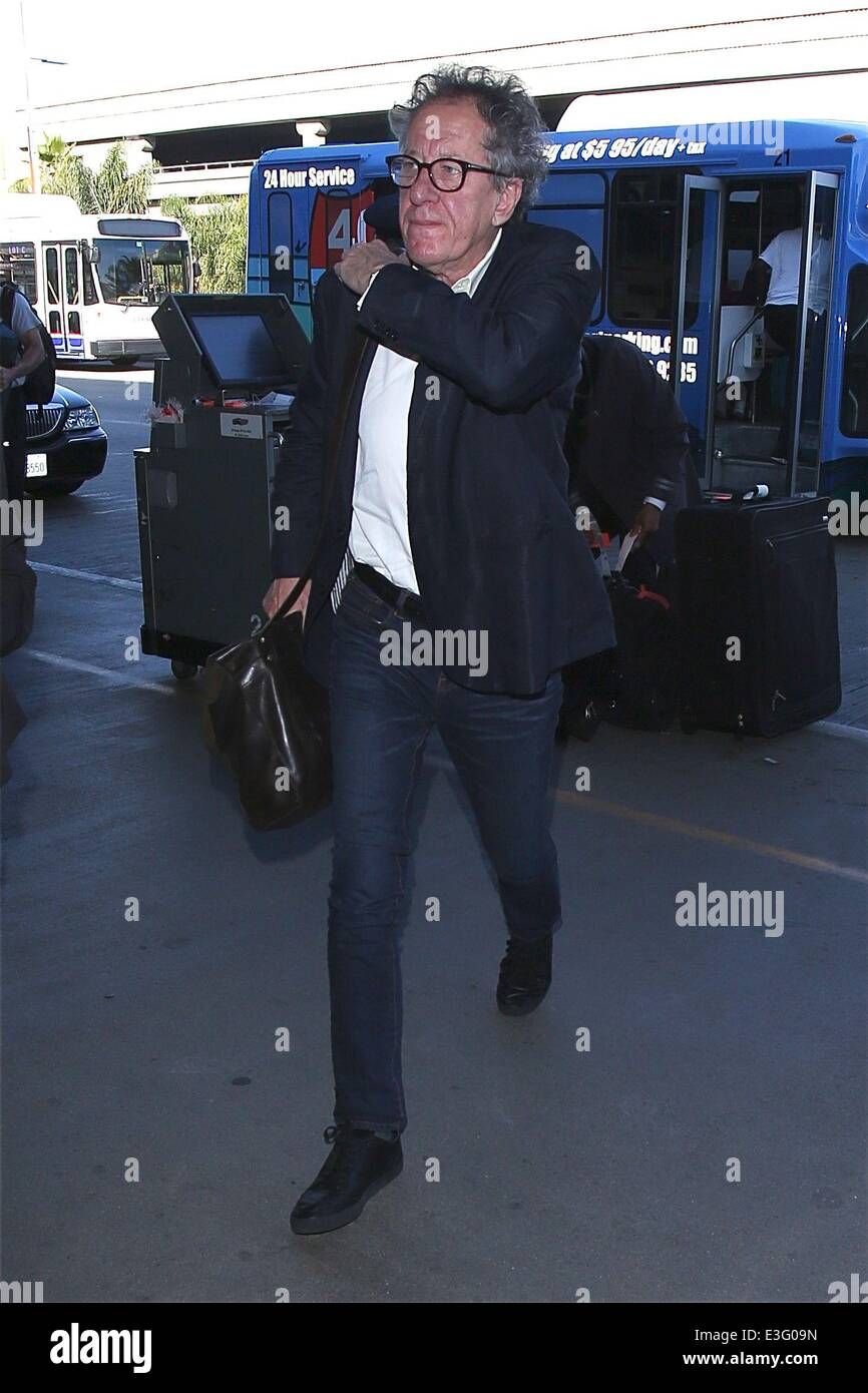 Geoffrey Rush in a rush at LAX airport to board his plane, as the actor was running very late  Featuring: Geoffrey - Stock Image