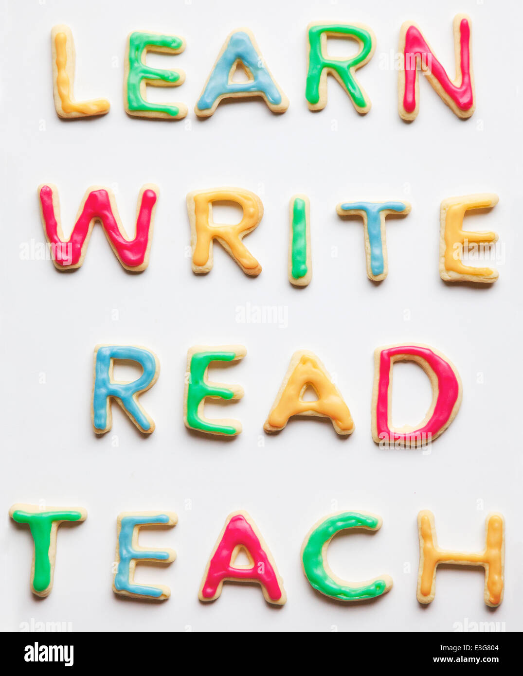 Learn Write Read and Teach decorated cookies - Stock Image