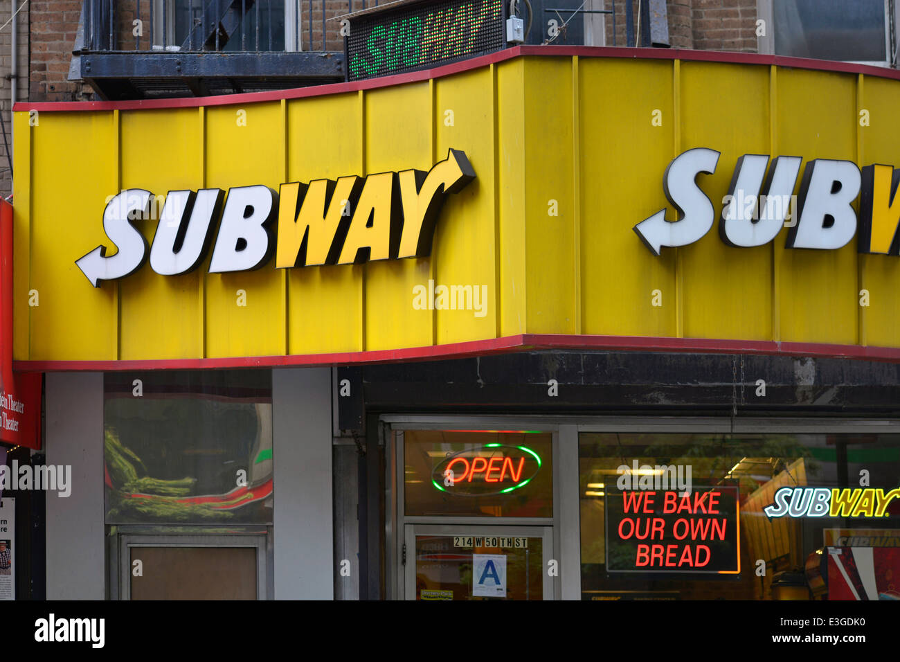 Subway Sandwiches Restaurant Sign above Entrance - Stock Image