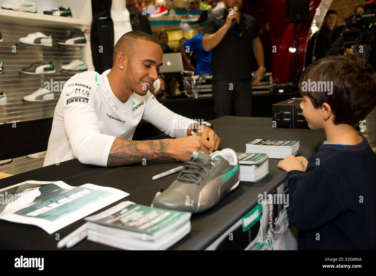 Lewis Hamilton signs autographs for Formula 1 fans at Shoe Palace at the Barton  Creek Square Mall Featuring  Lewis Hamilton Where  Austin e78a5209b