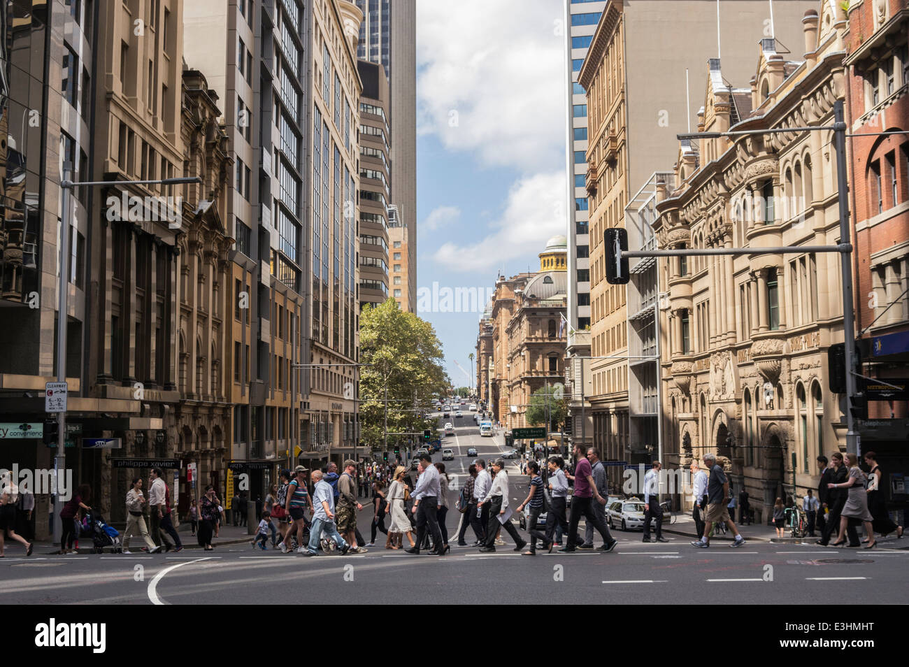 People crossing the road at the junction of Hunter and George Streets, Sydney, Australia. - Stock Image