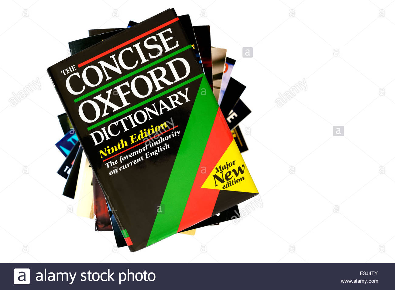 The Concise Oxford English Dictionary, stacked used books, England - Stock Image