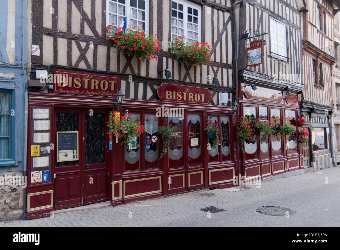 French bistro in old timber framed building. - Stock Image