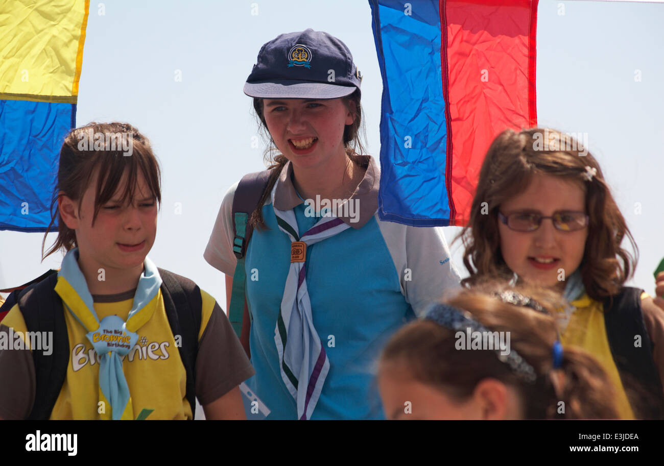 Girl Guide and Brownies boarding ferry to go across to Brownsea Island in Poole Harbour, Dorset in June - Stock Image