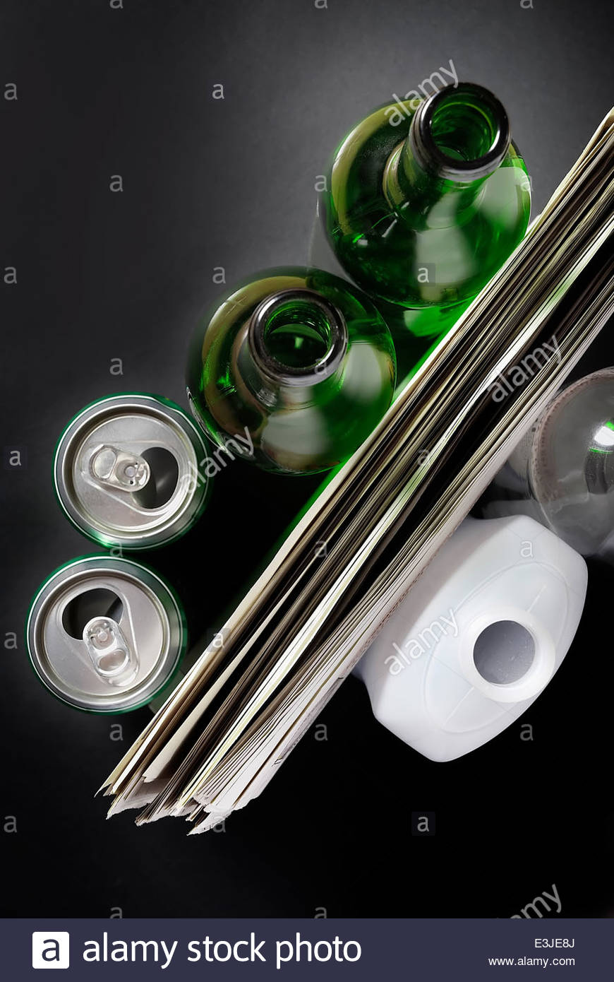 A collection of recyclable items on black background - Stock Image