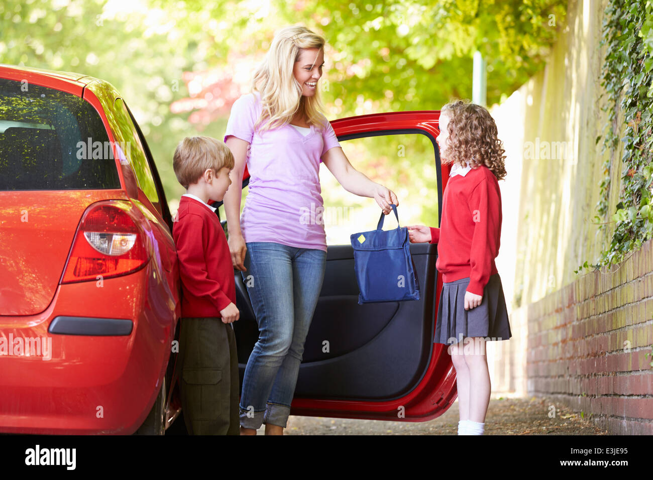 Mother Driving To School With Children - Stock Image