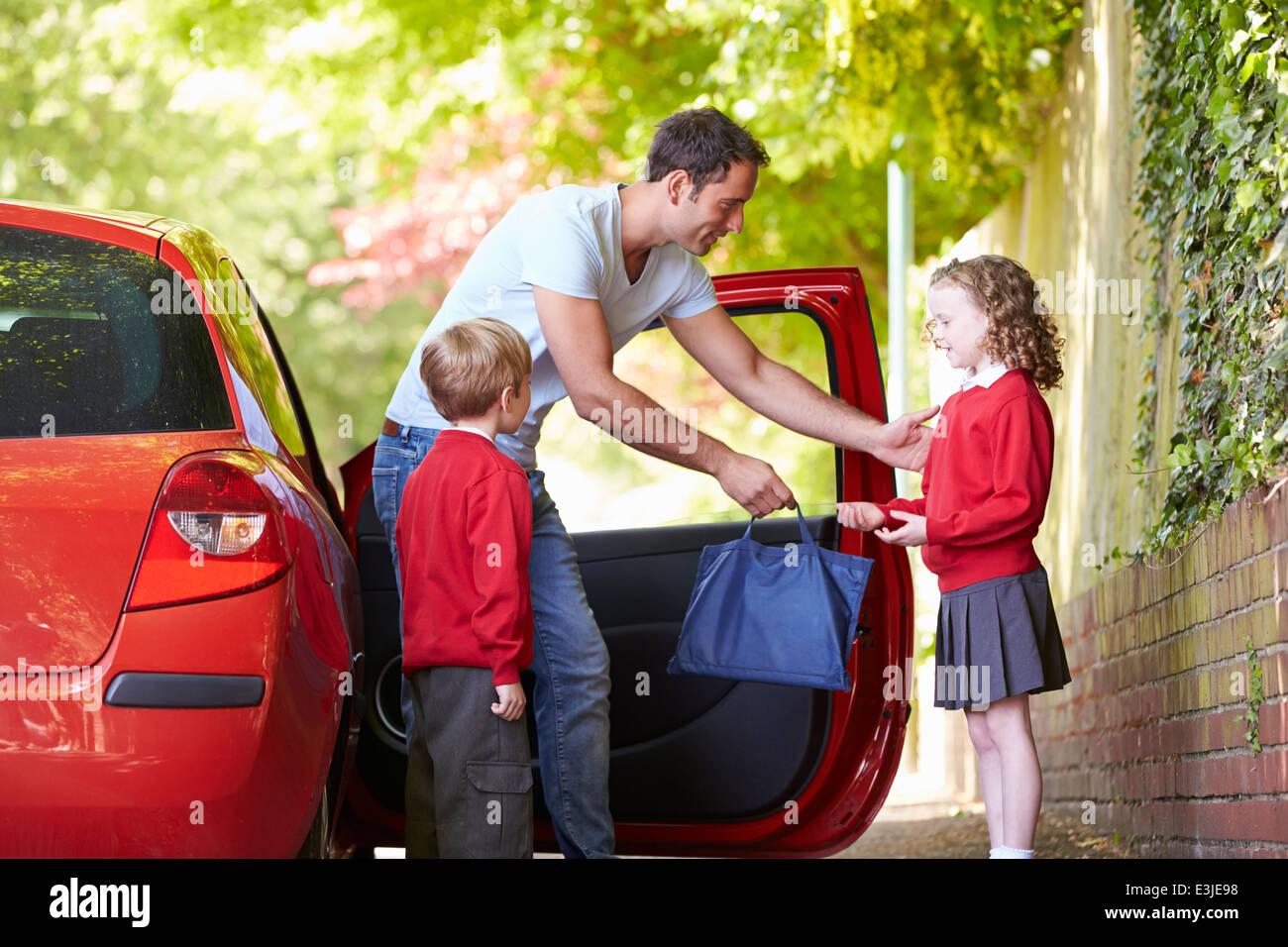 Father Driving To School With Children - Stock Image