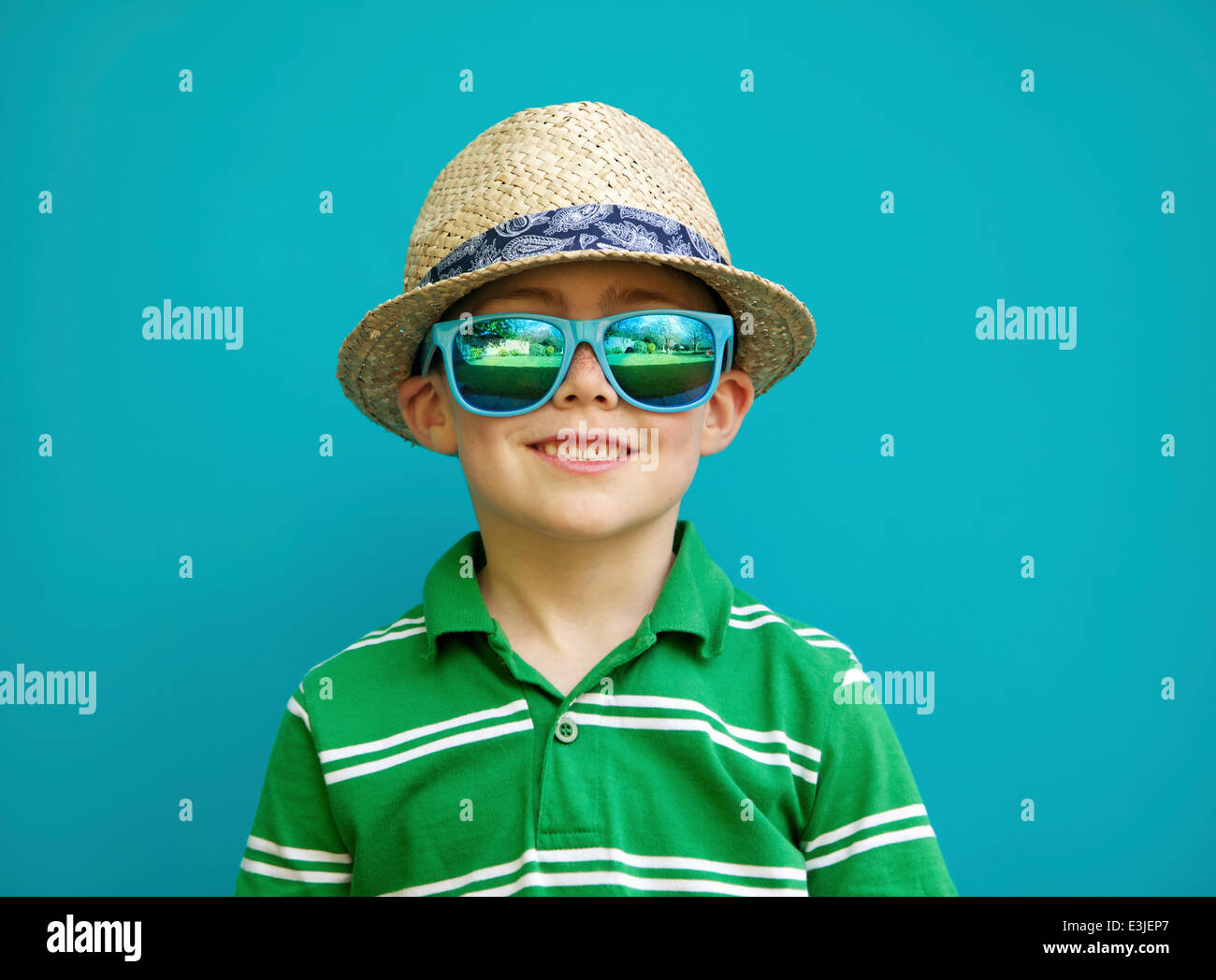 Smiling Boy Wearing Straw Hat and Sunglasses Stock Photo