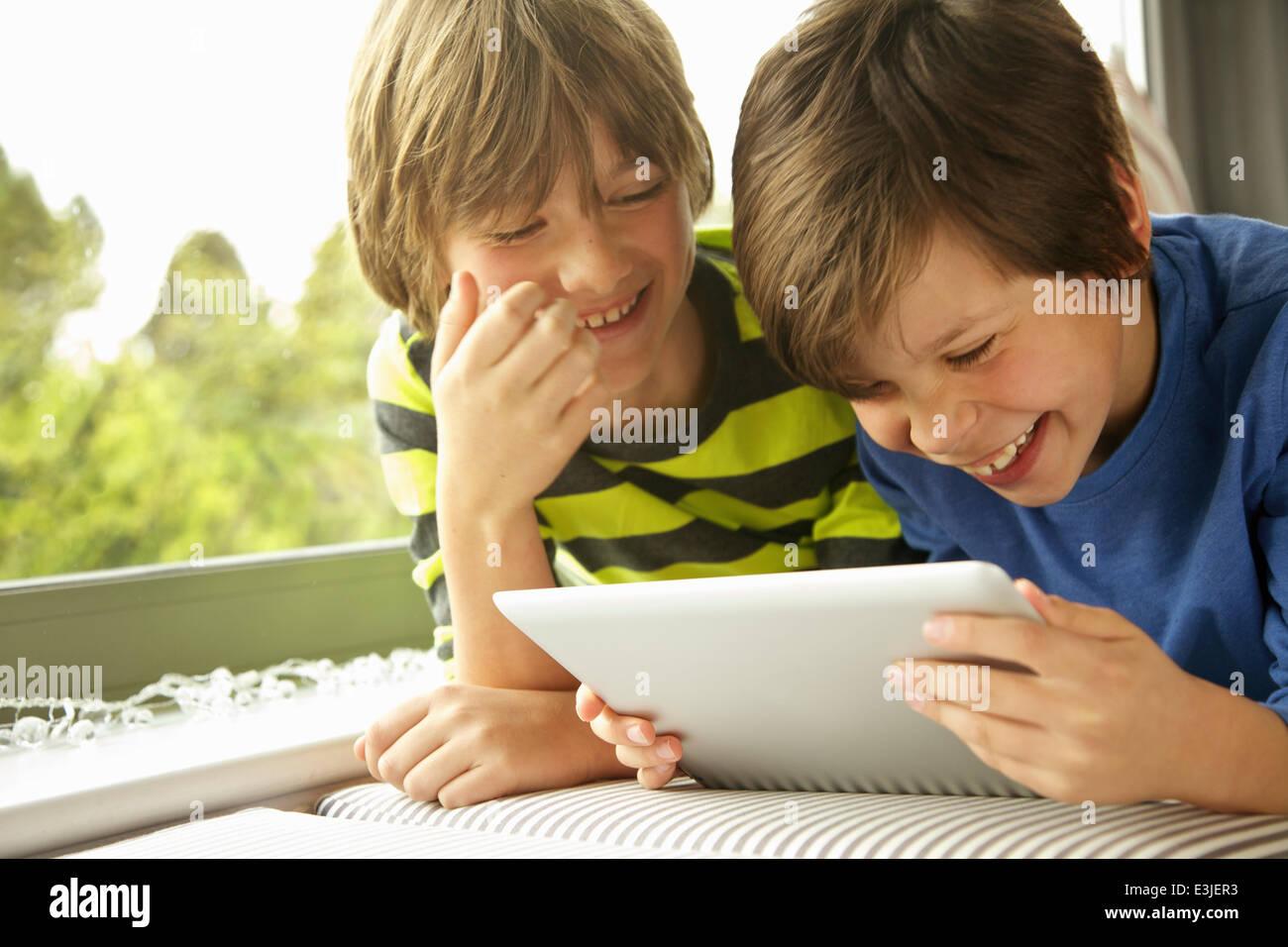 Boys Using Digital Tablet Smiling Stock Photo