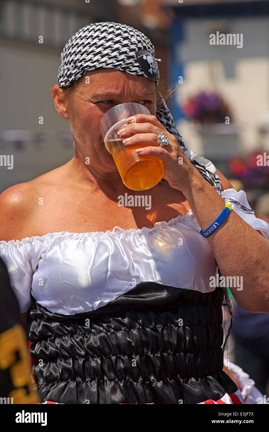pirate enjoying a pint at Poole Quay at Harry Paye Day – Poole's annual celebration of its favourite pirate son - Stock Image