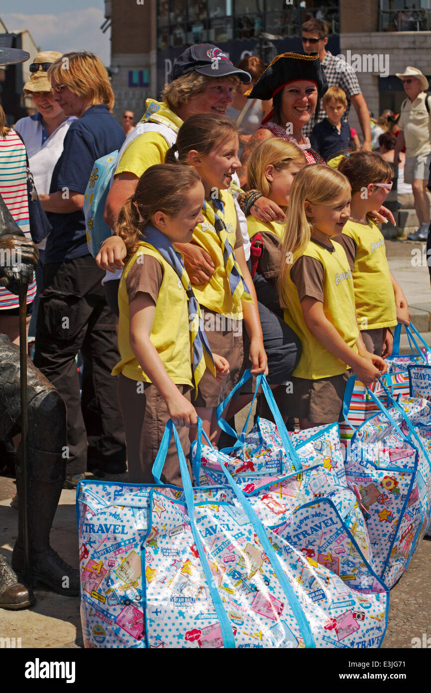 Brownies with bags ready to board ferry to go across to Brownsea Island in Poole Harbour, Dorset in June Stock Photo