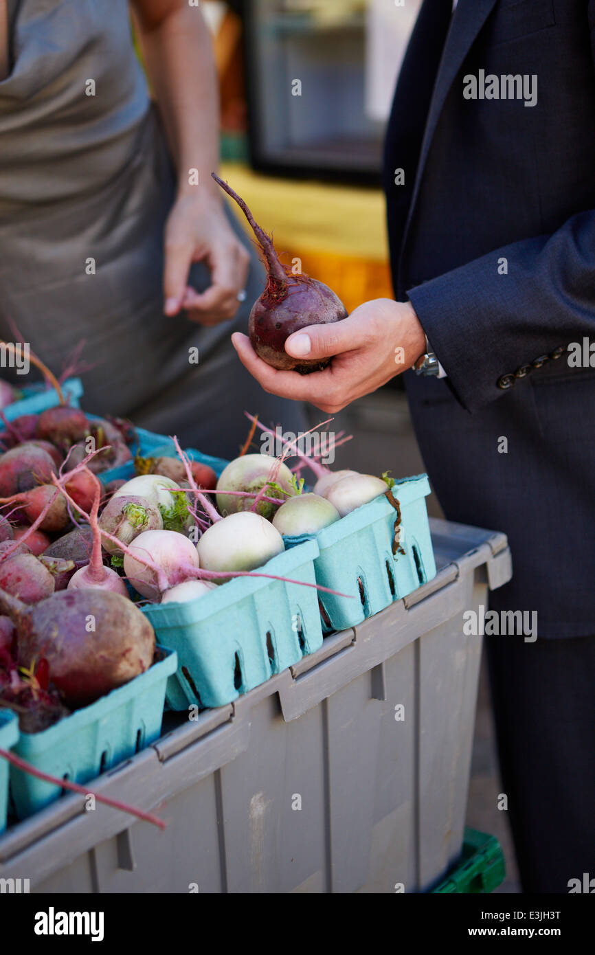 Man's Hand Holding Red Beet Stock Photo