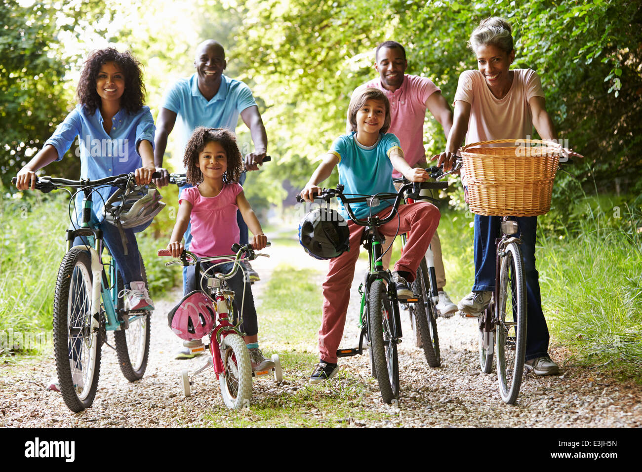 Multi Generation African American Family On Cycle Ride - Stock Image