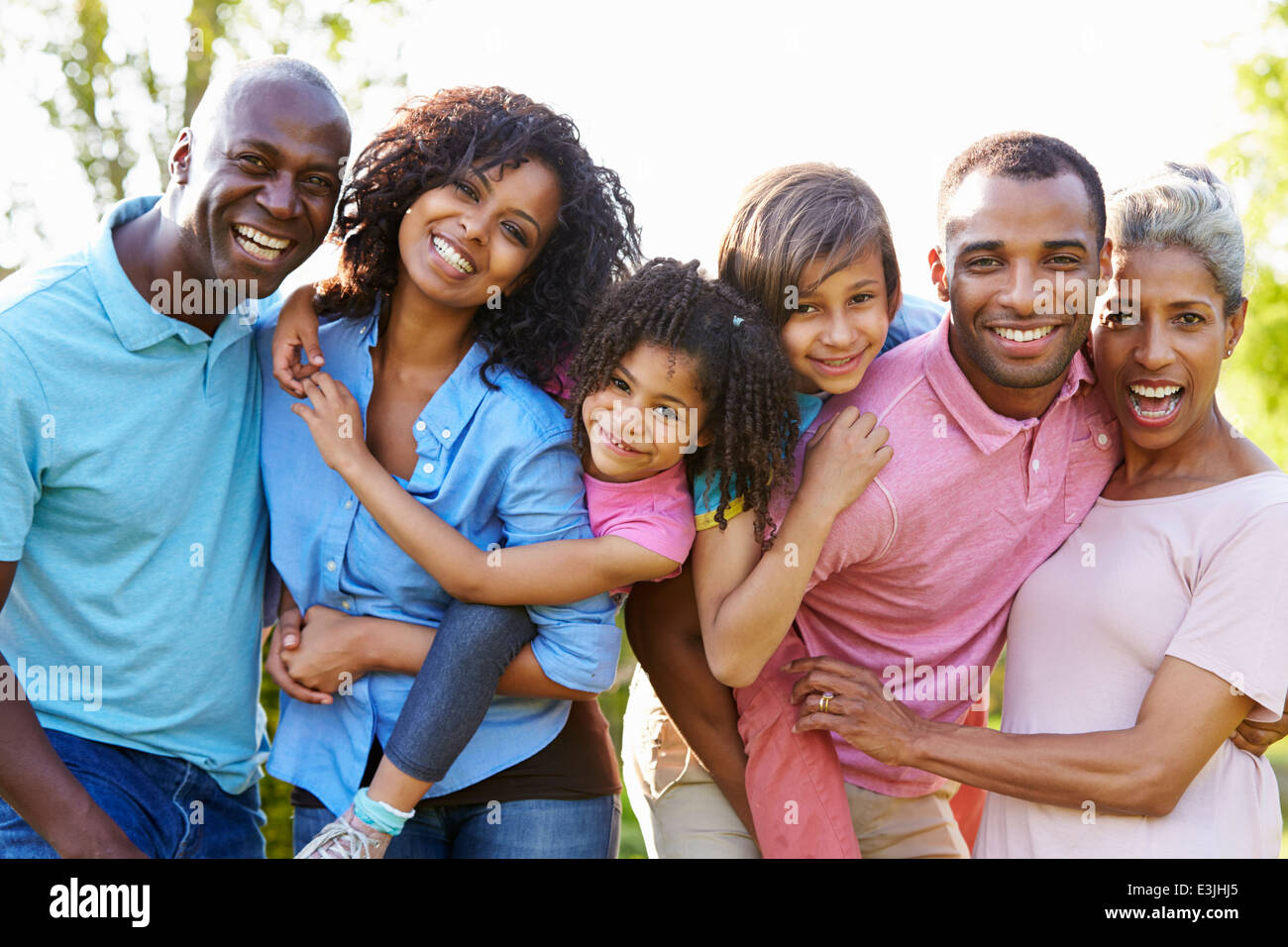Multi Generation African American Family Standing In Garden - Stock Image