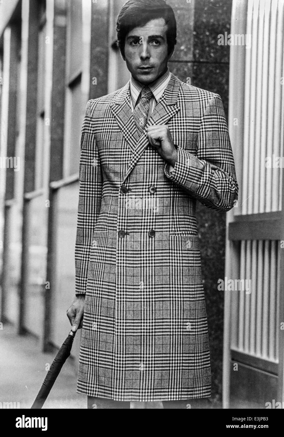 man 1970's style,model during a photo shoot - Stock Image
