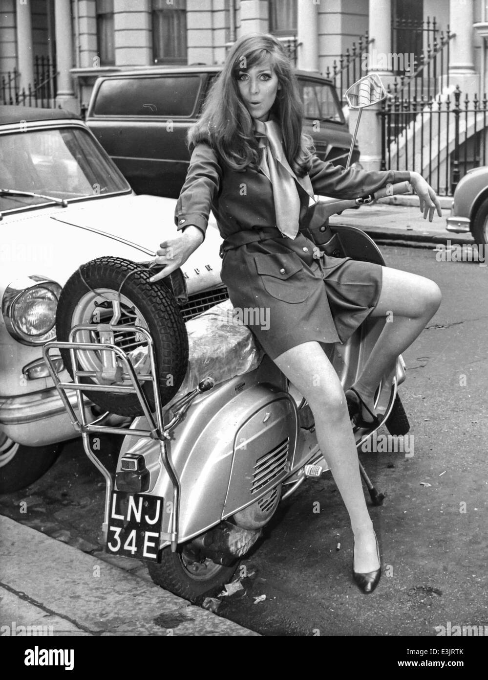 young woman on lambretta during a photographic service,1960's style - Stock Image