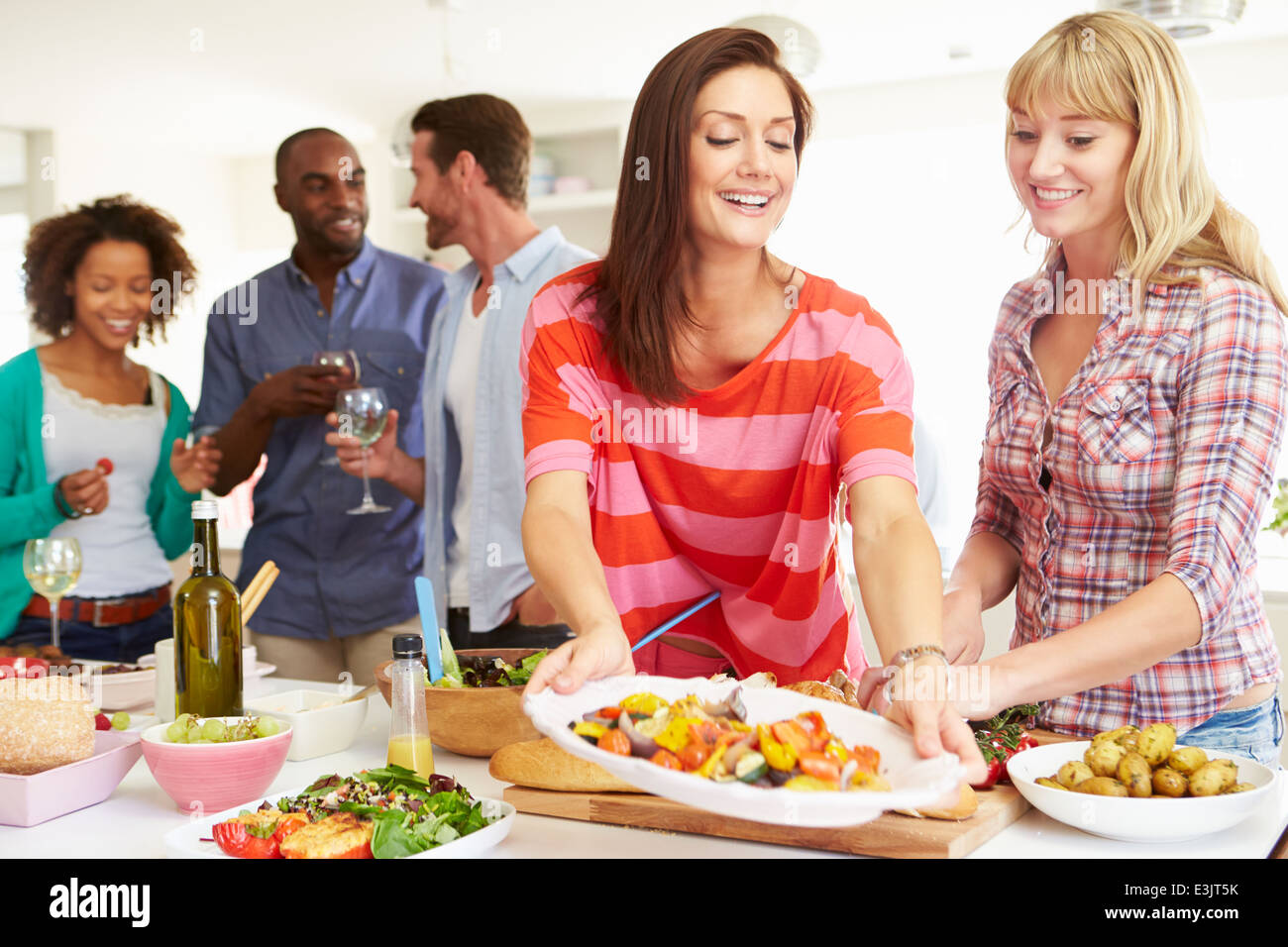 Group Of Friends Having Dinner Party At Home - Stock Image