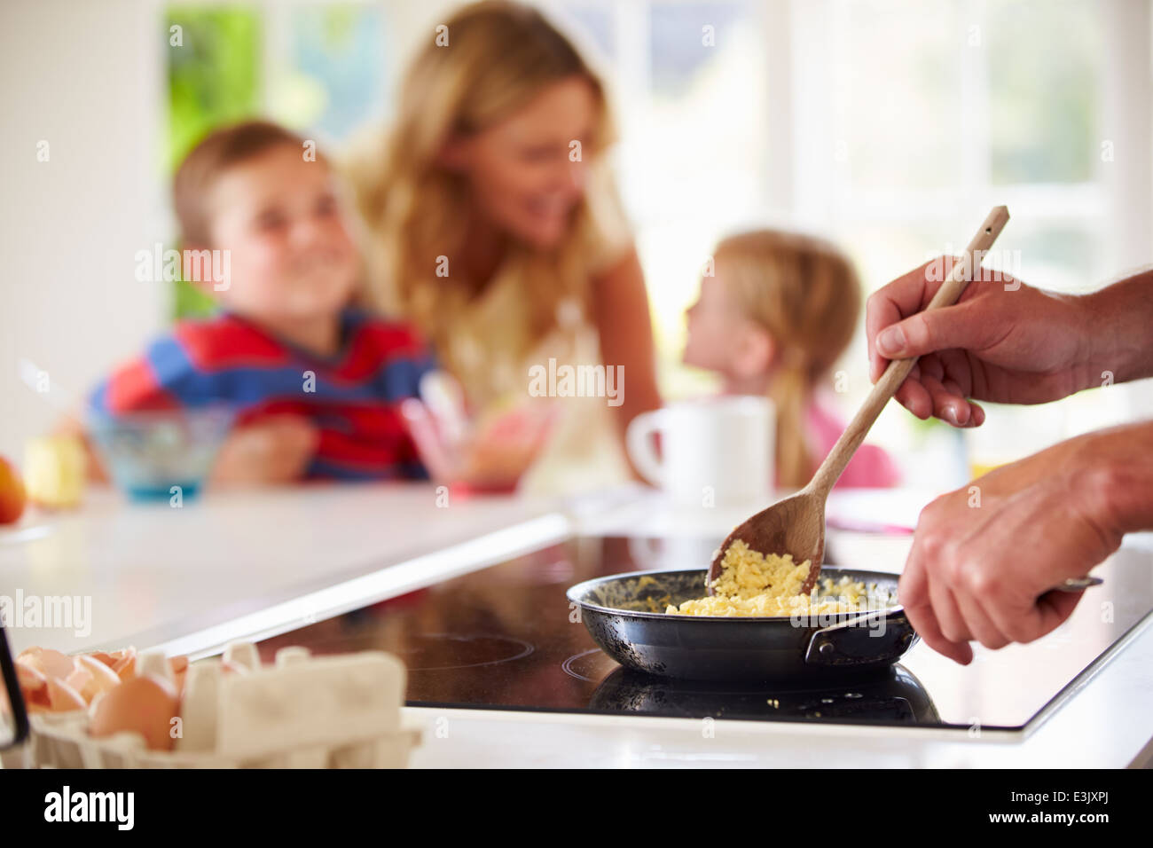 Close Up Of Father Preparing Family Breakfast In Kitchen Stock Photo