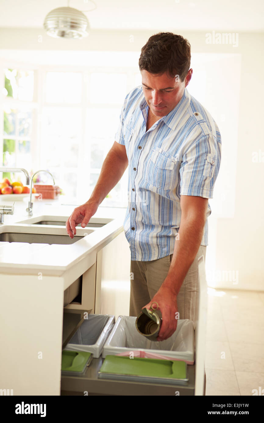 Man Recycling Kitchen Waste In Bin - Stock Image