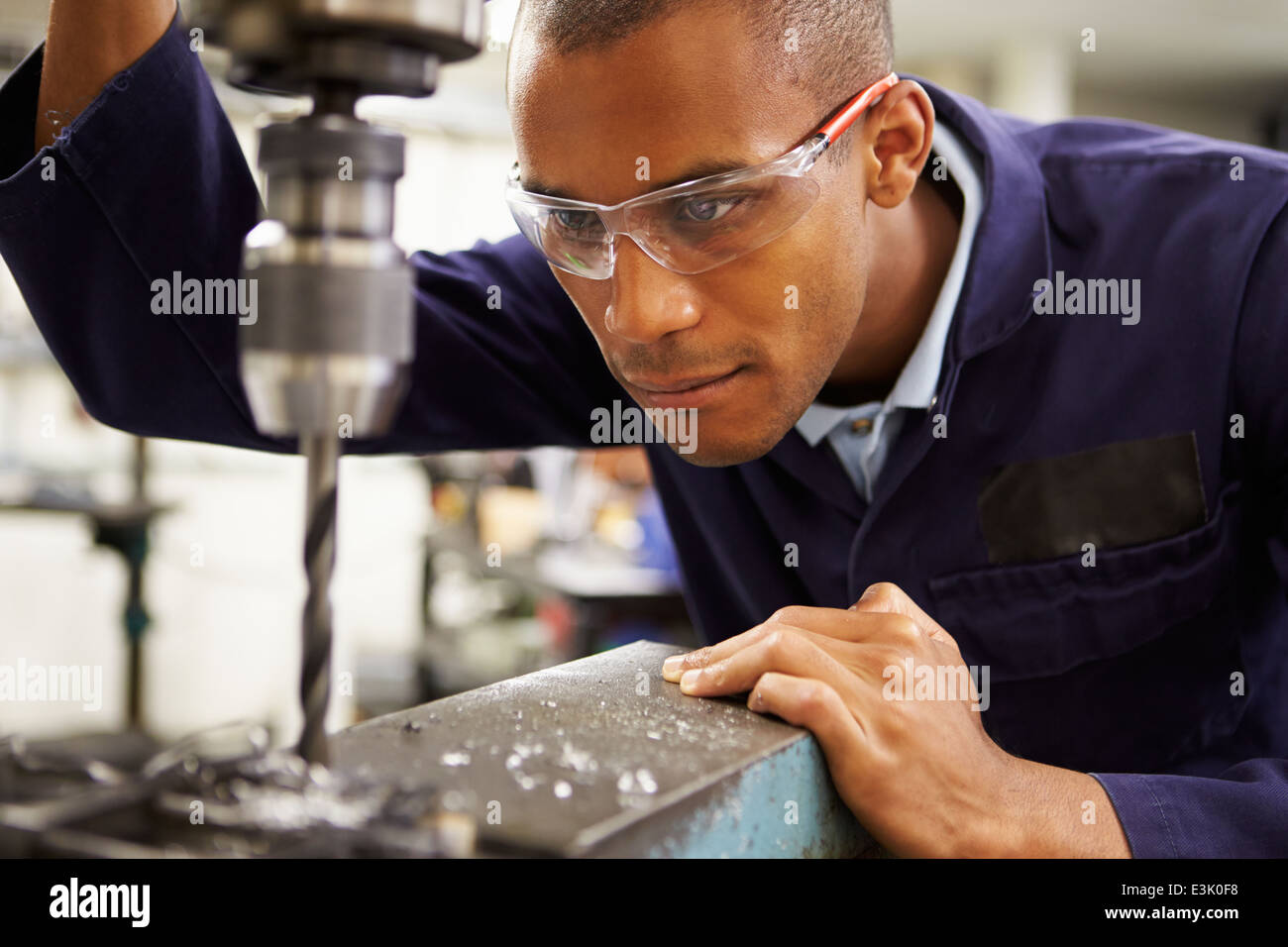 Apprentice Engineer Using Milling Machine - Stock Image