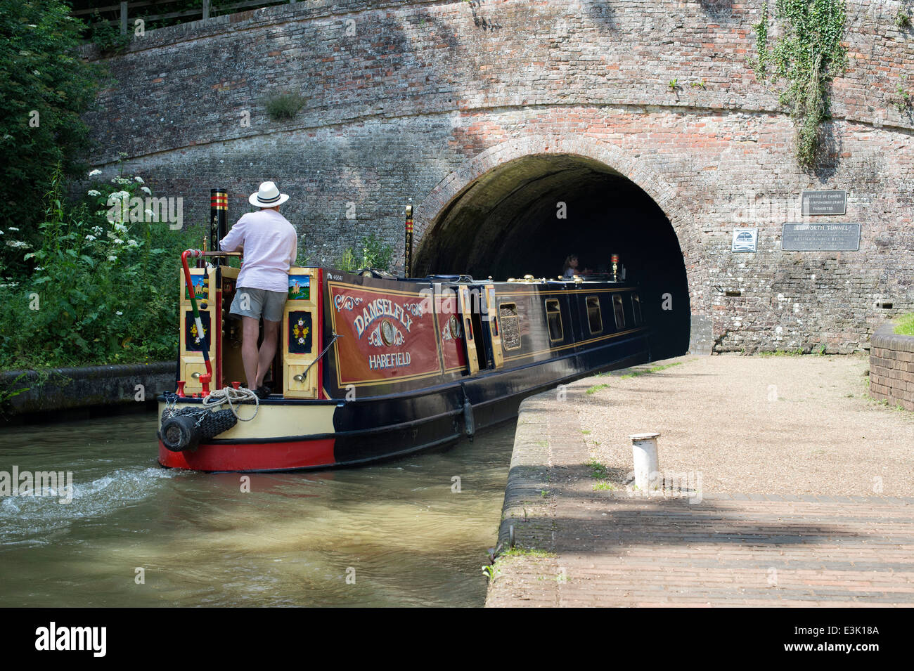 Narrowboat on the Grand Union Canal at Stoke Bruerne entering the Blisworth Tunnel. Northamptonshire. England - Stock Image