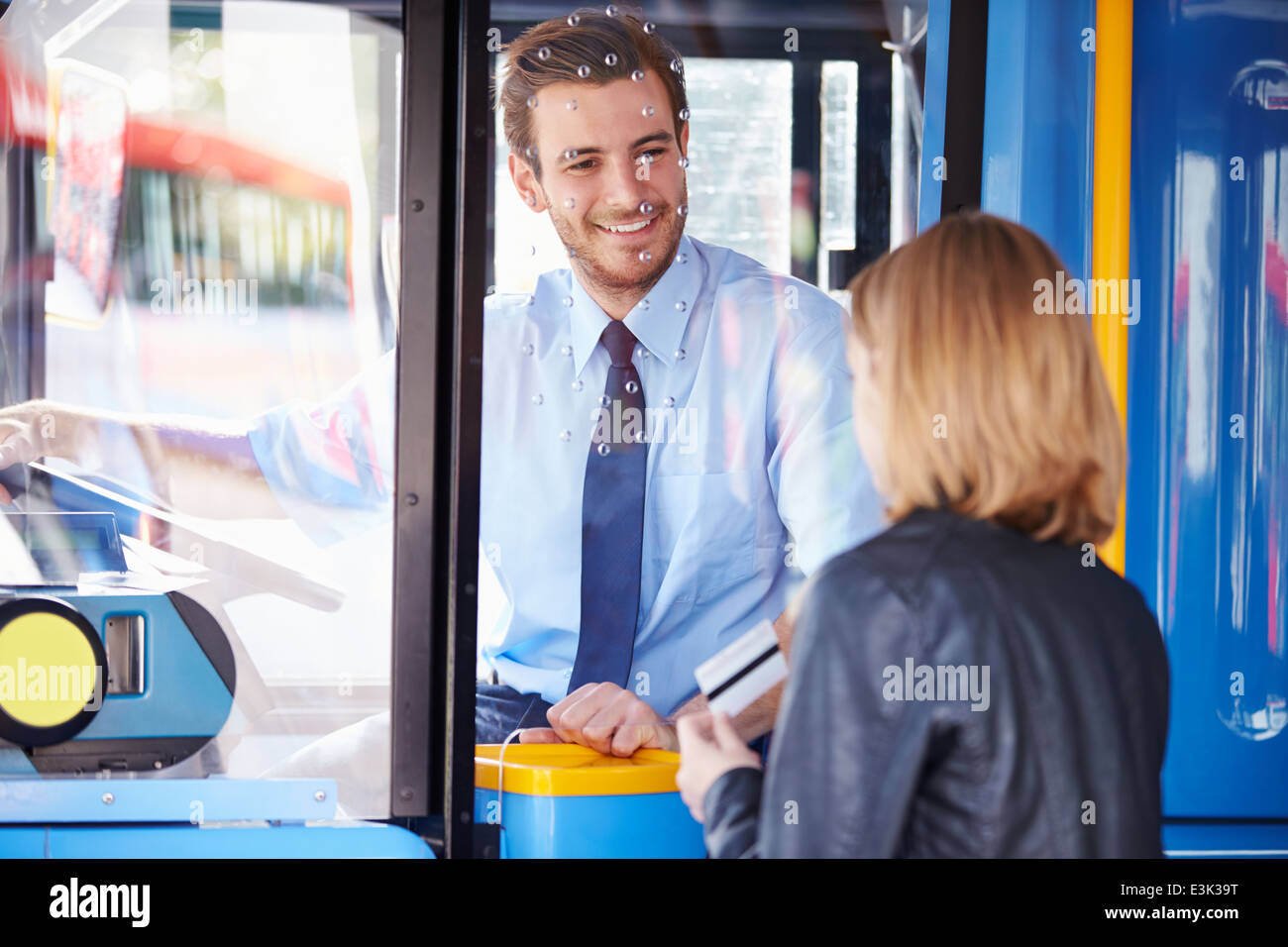 Woman Boarding Bus And Using Pass - Stock Image