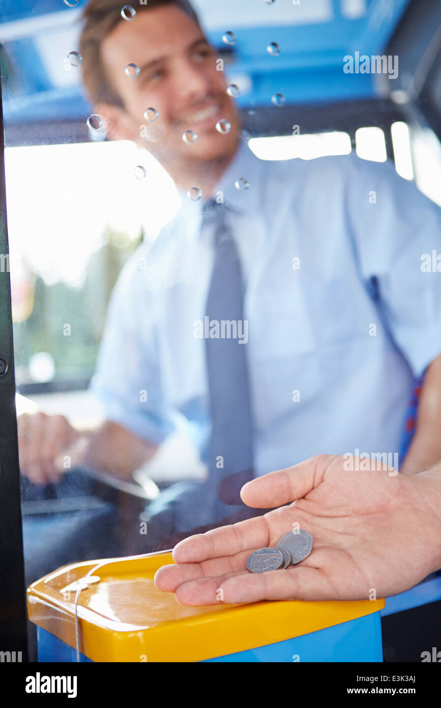 Close Up Of Hand Giving Driver Fare For Bus Journey - Stock Image