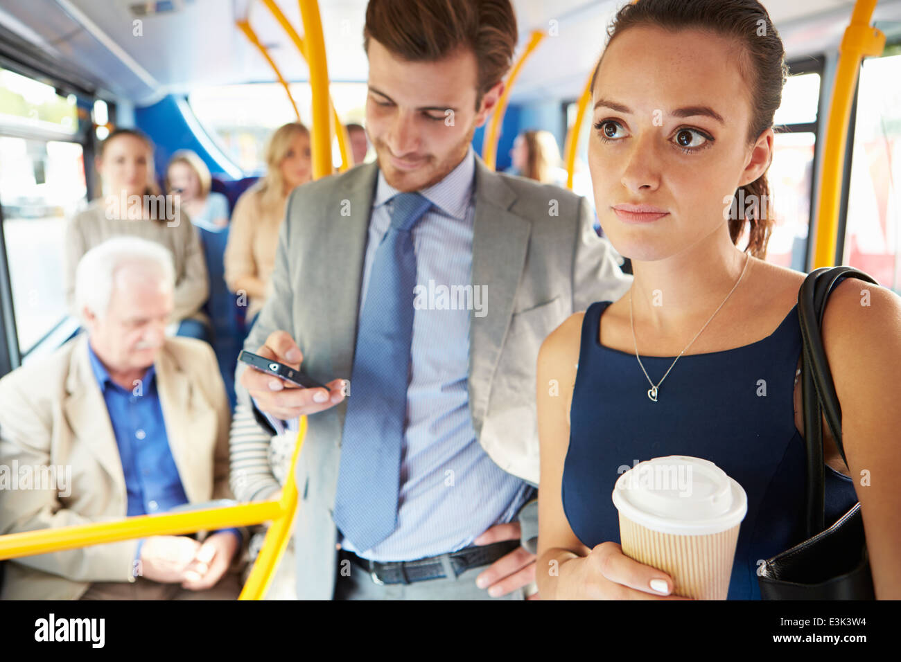 Passengers Standing On Busy Commuter Bus - Stock Image