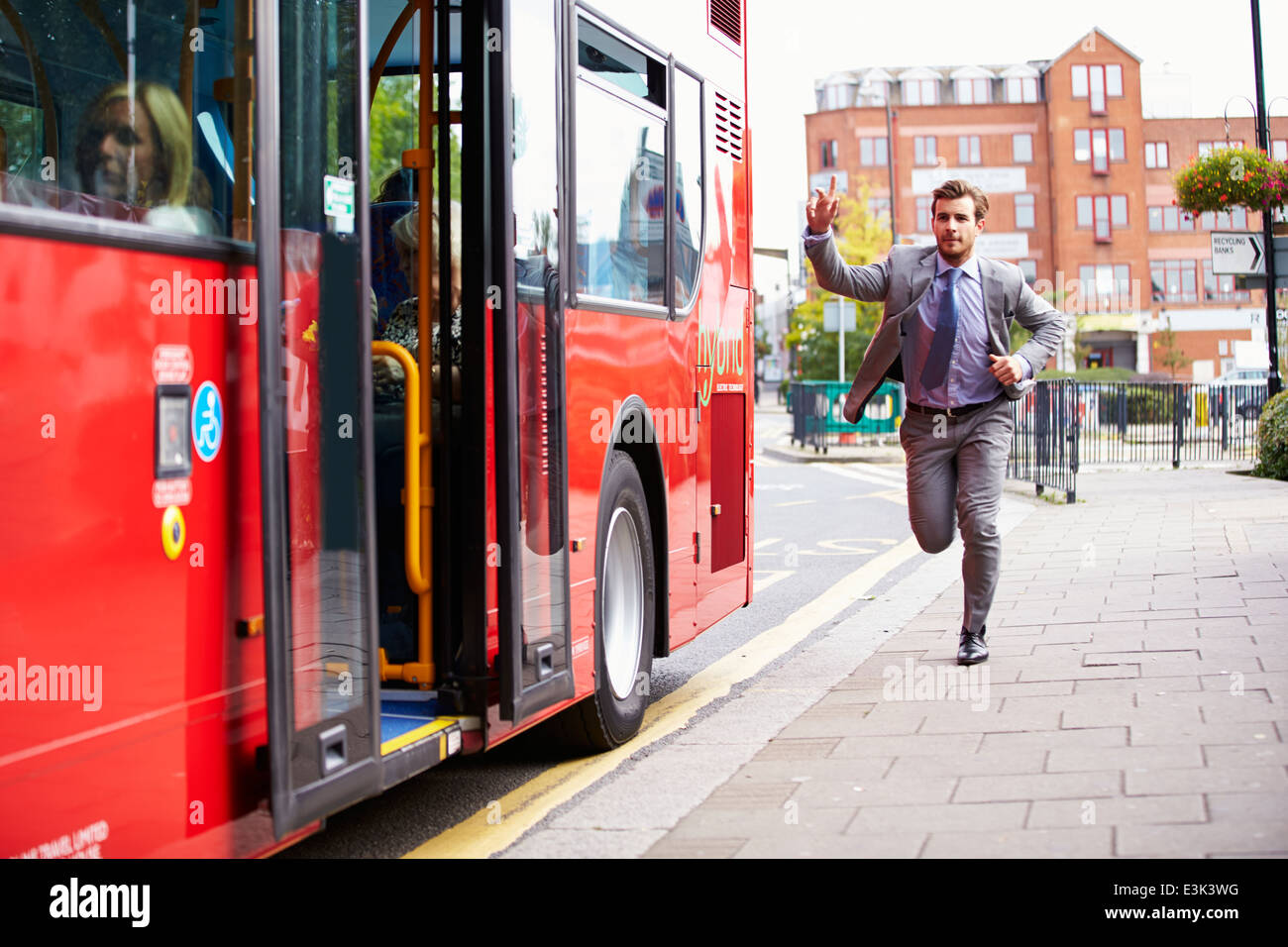 Businessman Running To Catch Bus Stop - Stock Image