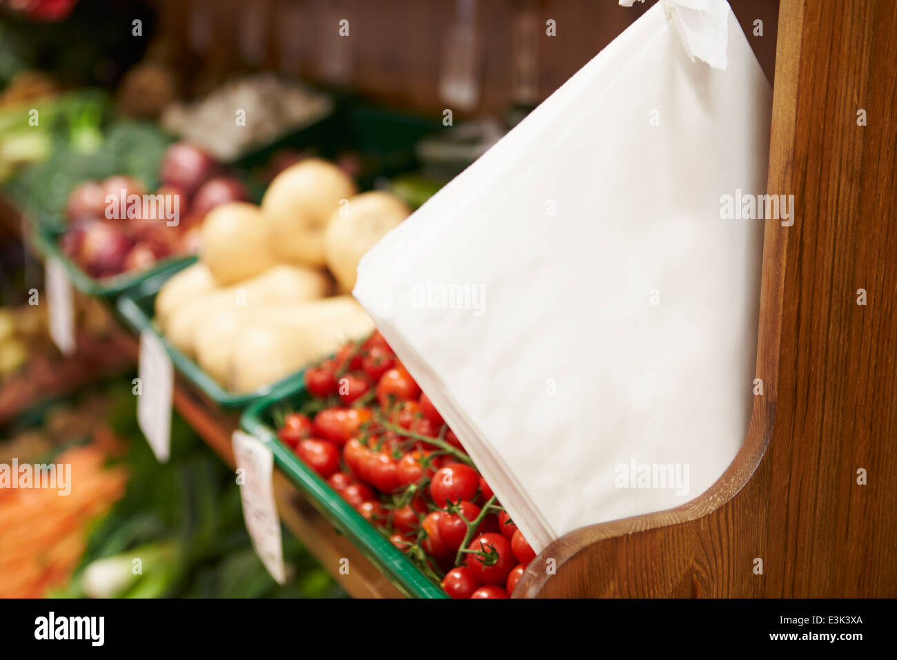 Paper Bags By Fruit Counter Of Farm Shop - Stock Image