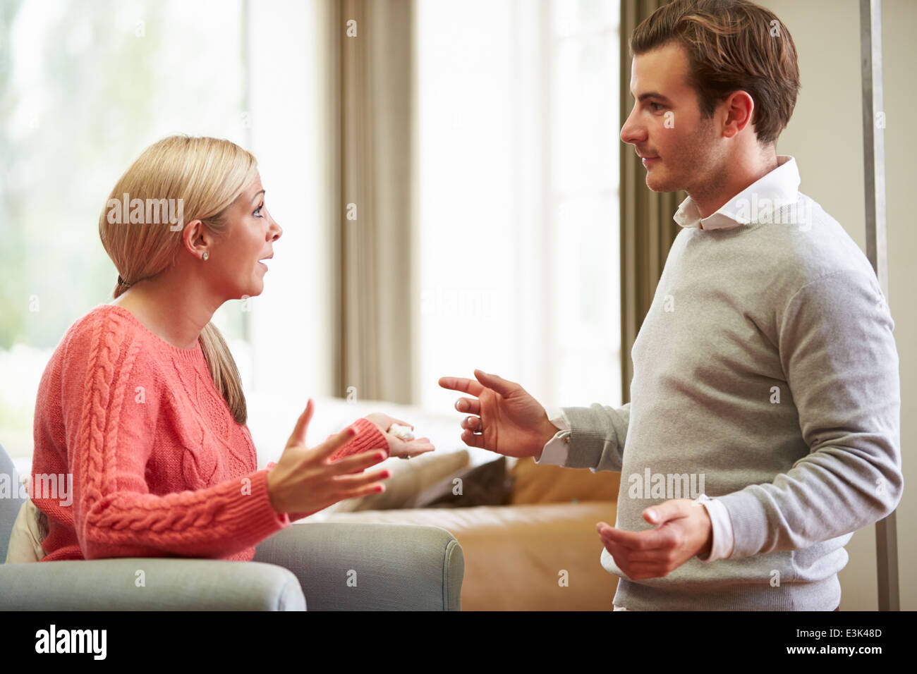 Young Couple Having Argument At Home - Stock Image