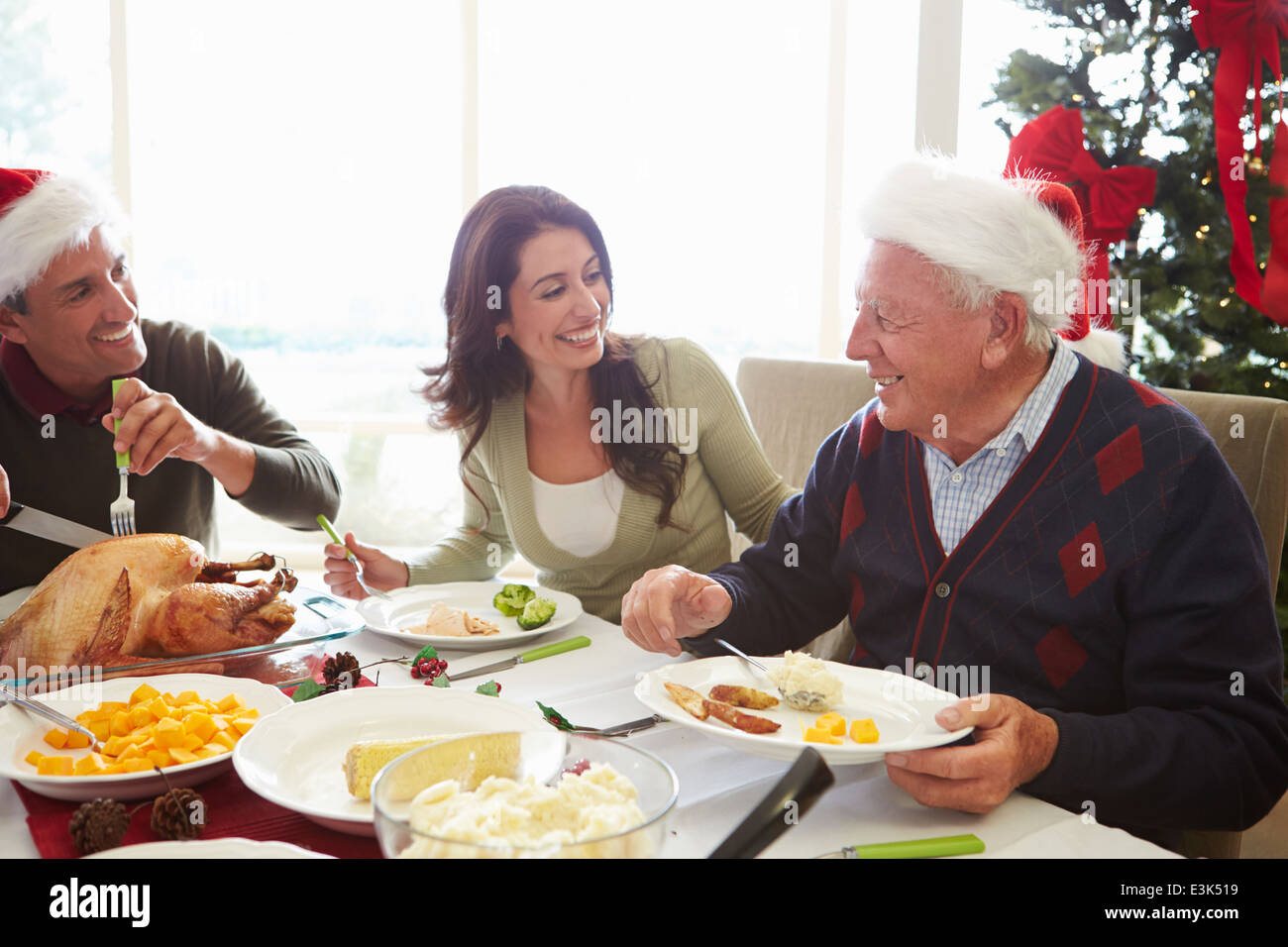 Senior Man Looking At Photo Album Through Window - Stock Image