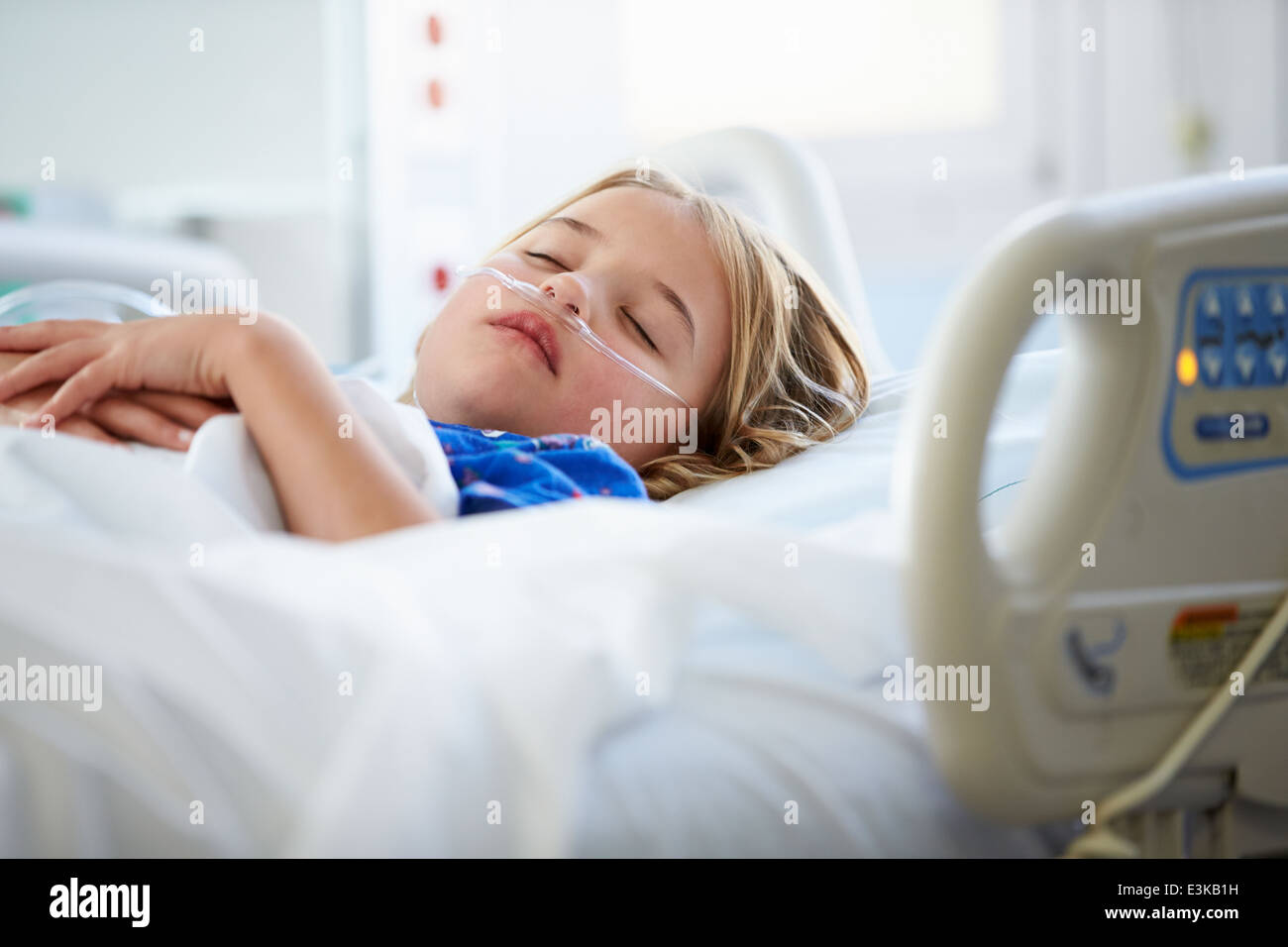 Young Girl Sleeping In Intensive Care Unit - Stock Image