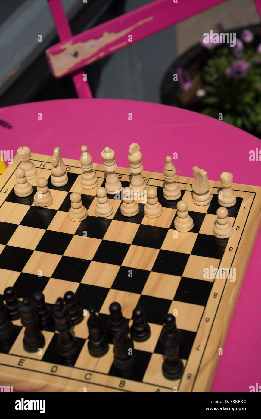 Chessboard with set out chess pieces - Stock Image
