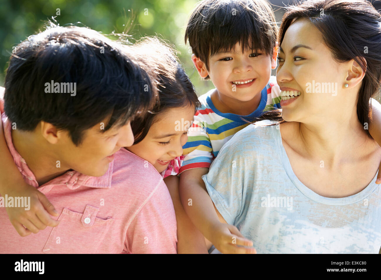 Asian Family Enjoying Walk In Summer Countryside - Stock Image