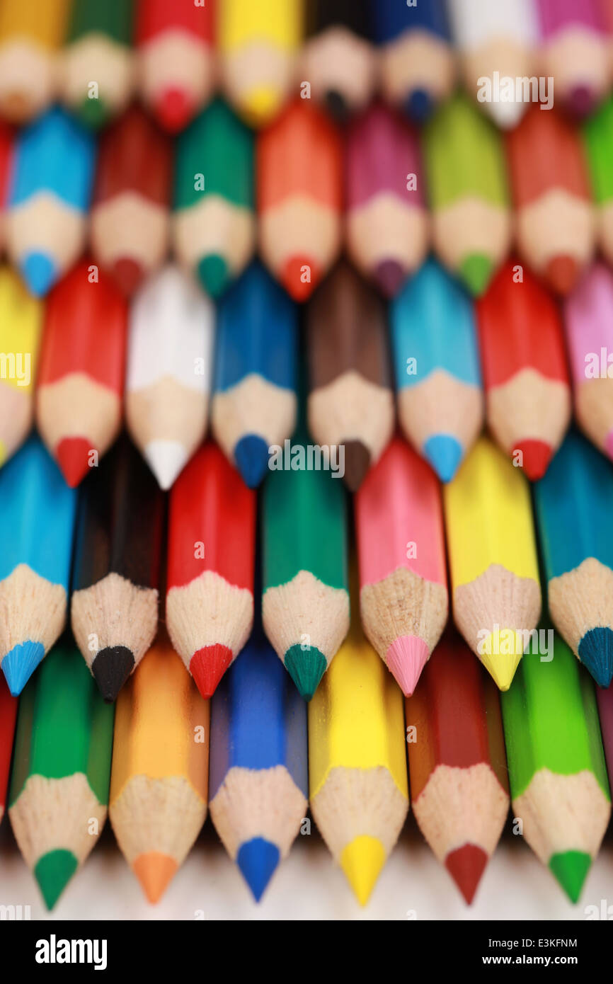 Close-up of a collection of colored pencil crayons - Stock Image